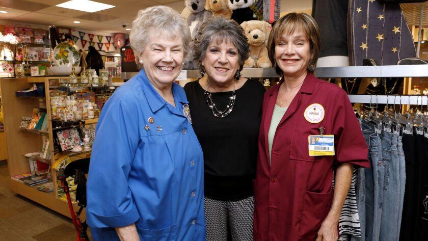Left to right, Providence St. Joseph Medical Center gift shop chairman Jackie Van Beveren, left, sto