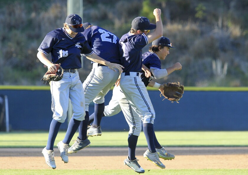 San Marcos infielders celebrate their win against Rancho Bernardo in the Lions Tournament Open Division championship game last year.