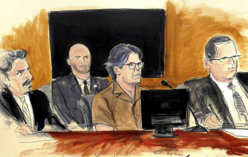 In this April 13, 2018, courtroom sketch Keith Raniere, second from right, leader of the secretive group NXIVM, attends a court hearing in the Brooklyn borough of New York.