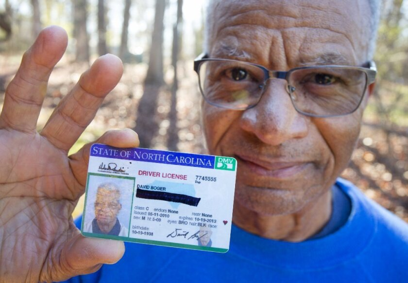 David Boger blacked out his address on a driver's license to protest North Carolina's voter ID law as he cast his ballot in Greensboro, N.C., on March 15.