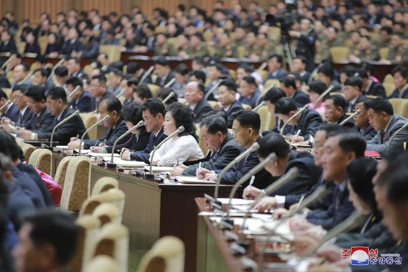 """In this photo provided by the North Korean government, members of the Supreme People's Assembly attend a meeting in Pyongyang, North Korea Sunday, Jan. 17, 2021. North Korea's rubber-stamp parliament has passed decisions made by a major ruling party meeting where leader Kim Jong Un vowed to bolster his nuclear deterrent and established plans to salvage a dismal economy. Independent journalists were not given access to cover the event depicted in this image distributed by the North Korean government. The content of this image is as provided and cannot be independently verified. Korean language watermark on image as provided by source reads: """"KCNA"""" which is the abbreviation for Korean Central News Agency. (Korean Central News Agency/Korea News Service via AP)"""
