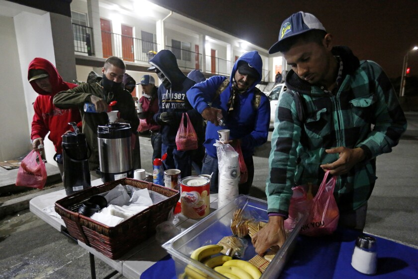 Seasonal agricultural workers holding H-2A visas have breakfast in Salinas.