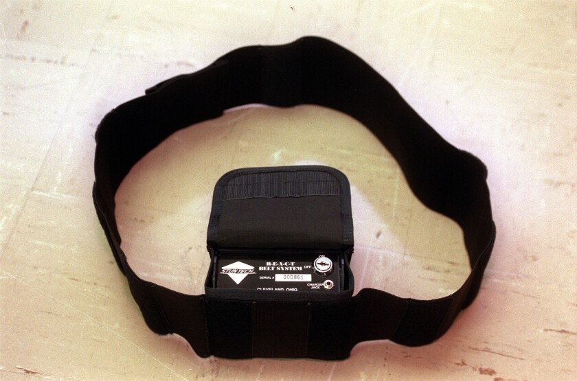 A stun belt, sometimes worn by criminal defendants in court, can deliver an electric shock to the wearer.