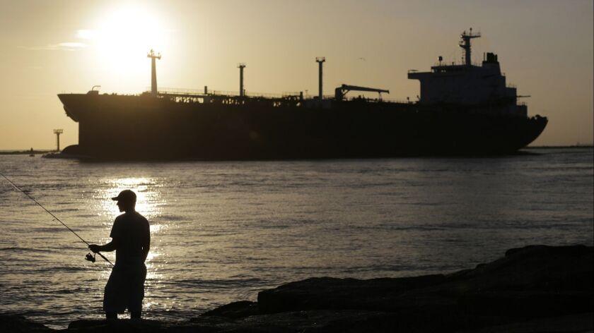An oil tanker enters a channel near Port Aransas, Texas, heading for the Port of Corpus Christi.