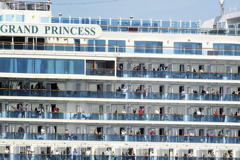 Passenger aboard the Grand Princess celebrate as they arrive in Oakland, Calif., on Monday, March 9, 2020. The cruise ship, which had maintained a holding pattern off the coast for days, is carrying multiple people who tested positive for COVID-19, a disease caused by the new coronavirus. (AP Photo/Noah Berger)