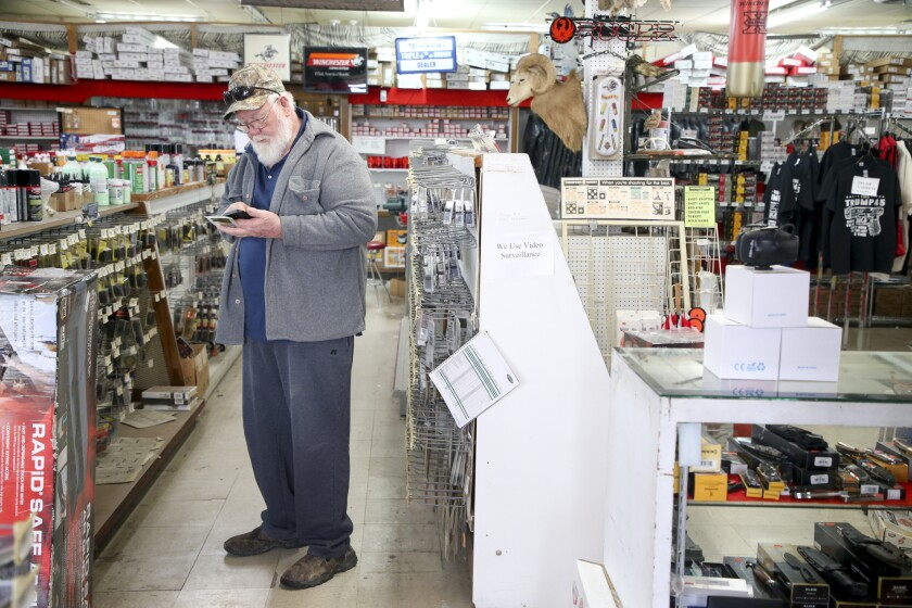 A customer shops at Dong's Guns, Ammo and Reloading in Tulsa, Okla.