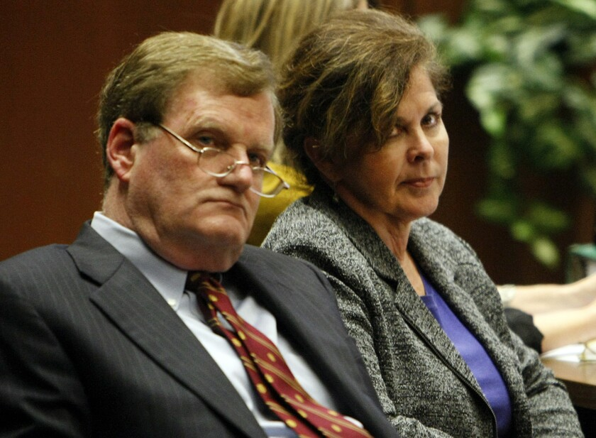 Former assistant city manager of Bell, Angela Spaccia, right, who is charged with misappropriation of public funds and other counts, listens to opening statements in Los Angeles Superior Court. At left is her attorney Harland Braun.