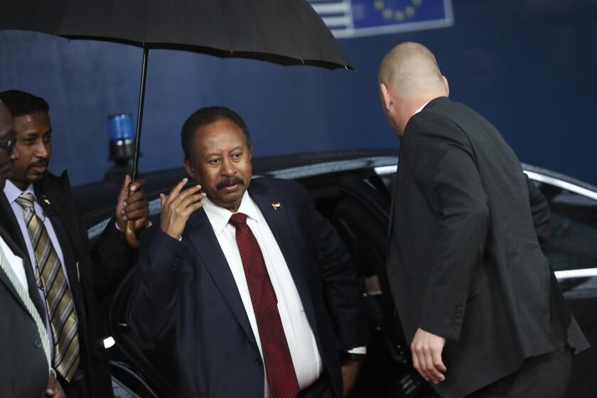 Sudan's Prime Minister Abdalla Hamdok arrives to the European Council headquarters in Brussels, Monday, Nov. 11, 2019. (AP Photo/Francisco Seco)