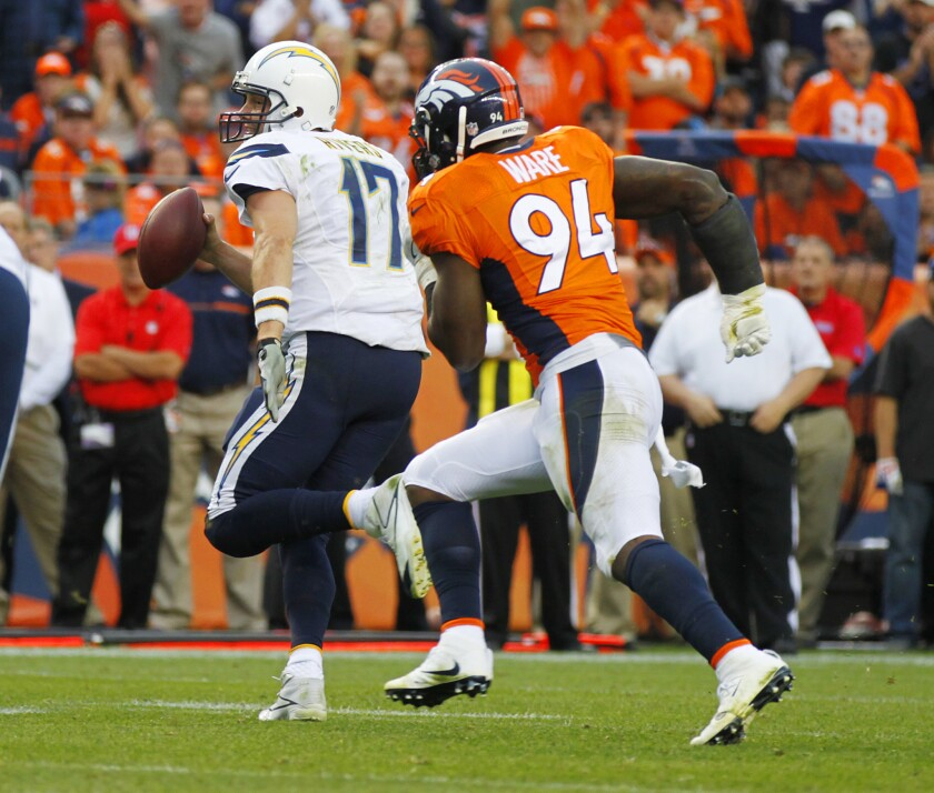 Philip Rivers is chased by Broncos' DeMarcus Ware in fourth quarter of Denver's win.