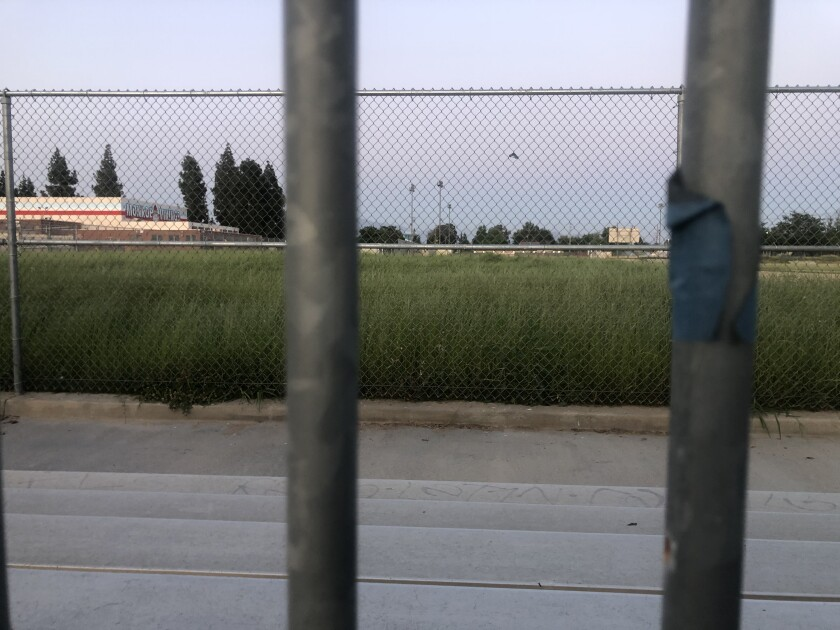 The Monroe High School baseball infield looks like it could need a good mowing after nearly two months of no use.