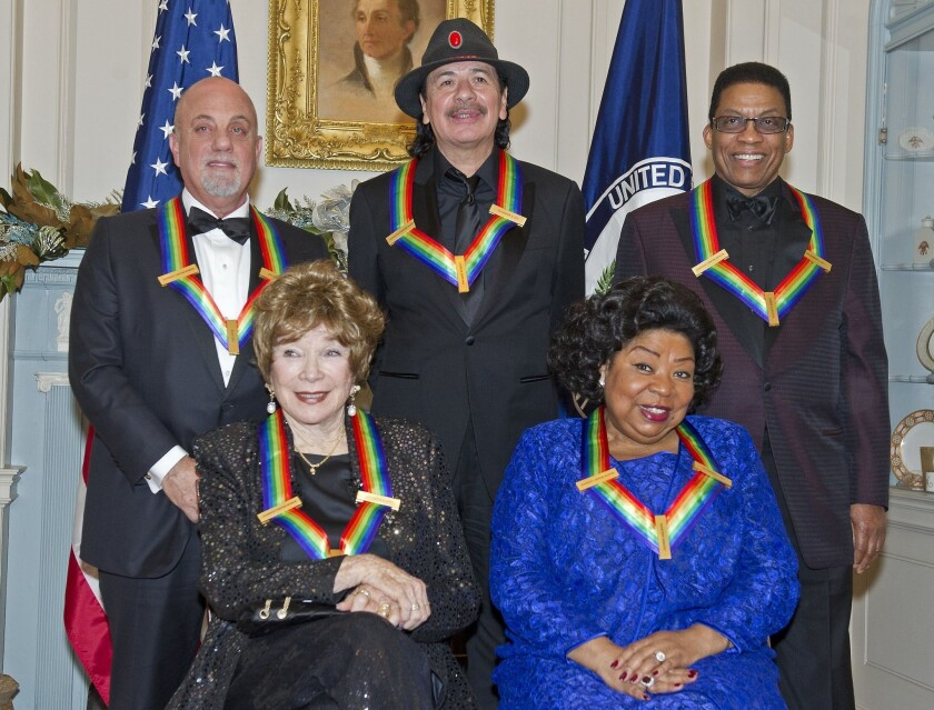 Herbie Hancock (top right) is shown with his fellow 2014 Kennedy Center Honor recipients. Seated in the front row, from left: Shirley MacLaine and Martina Arroyo. Standing, from left, are Billy Joel, Carlos Santana and Hancock.