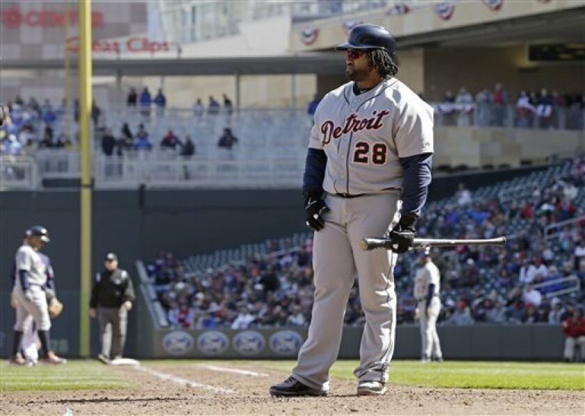 Detroit Tigers' Prince Fielder pauses after he was called out on strikes in the seventh inning of a baseball game against the Minnesota Twins, Thursday, April 4, 2013, in Minneapolis. Fielder went hitless as the Twins won 8-2. (AP Photo/Jim Mone)