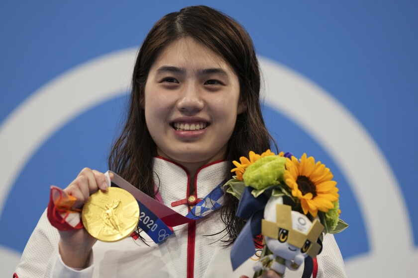 Zhang Yufei of China poses with her gold medal after winning the women's 200-meter butterfly final at the 2020 Summer Olympics, Thursday, July 29, 2021, in Tokyo, Japan. (AP Photo/Matthias Schrader)