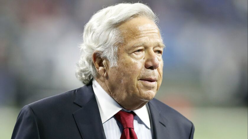 New England Patriots owner Robert Kraft walks the sidelines before a game in Detroit on Sept. 9.