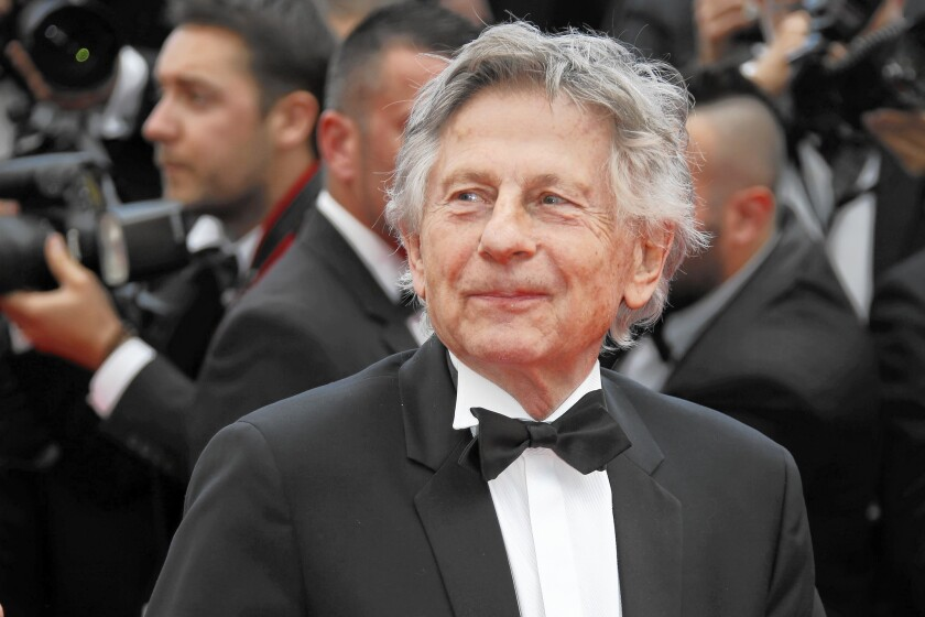 """Film director Roman Polanski arrives for the screening of the film """"Saint-Laurent"""" at the 67th edition of the Cannes Film Festival in Cannes in May 2014."""