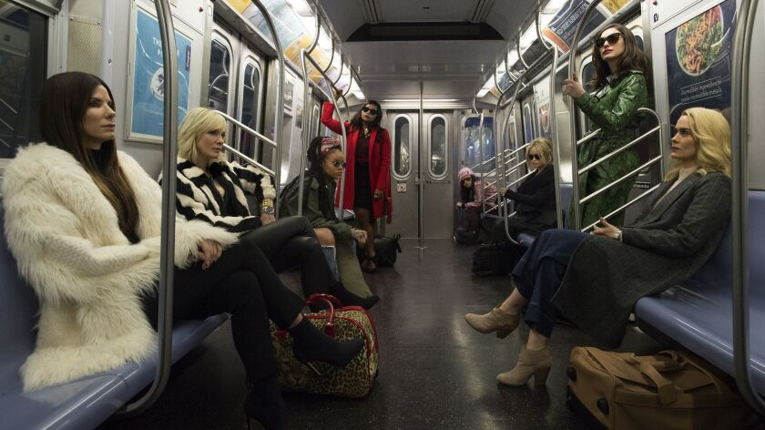 """In the summer film """"Ocean's 8,"""" style and a heist go hand-in-hand. The movie stars, clockwise from front left, Sandra Bullock, Cate Blanchett, Rihanna, Mindy Kaling, Awkafina, Helena Bonham Carter, Anne Hathaway and Sarah Paulson."""