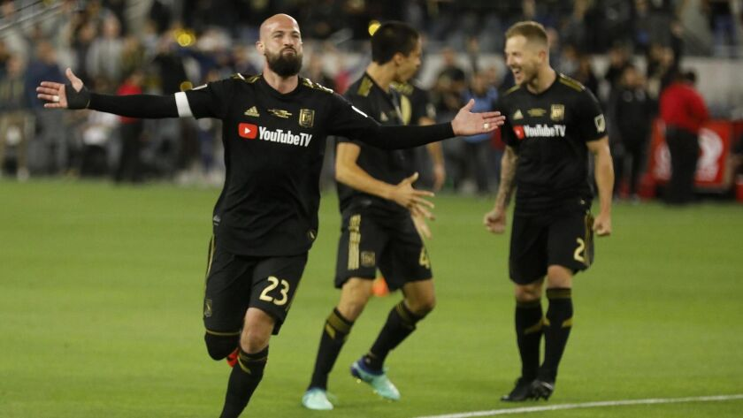 LAFC's Laurent Ciman acknowledges the cheers from the crowd after scoring the game-winning goal against the Sounders during its debut at Banc of California Stadium on April 29, 2018.