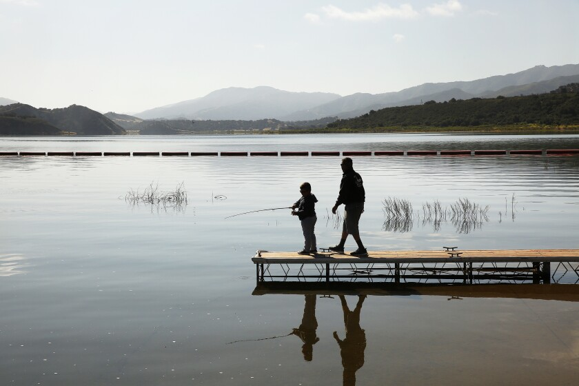 Danny Santistevan and his grandson, Mario Antonio Garcia, 6, fish at Cachuma Reservoir.