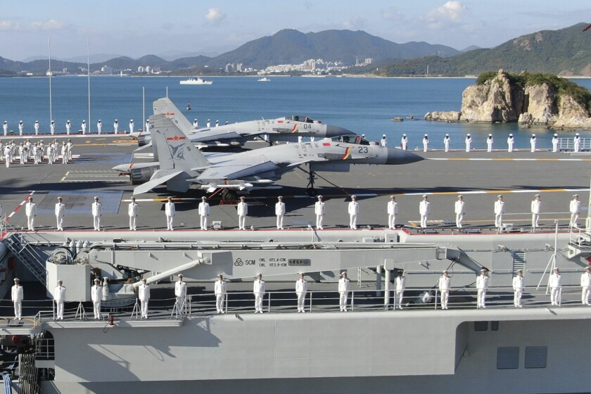 China's new Shandong aircraft carrier with sailors lined up