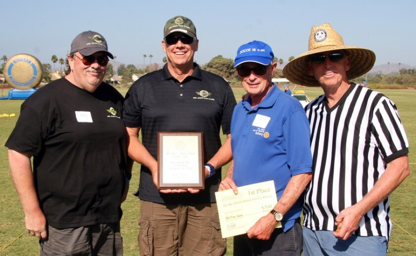 (L-R) Bill Seifen and Jeff Neufeld took top honors at the Del Mar-Solana Beach Rotary Club's 21st Annual Bocce Tournament, shown here with club members Jon Fish and Kirk Collins.