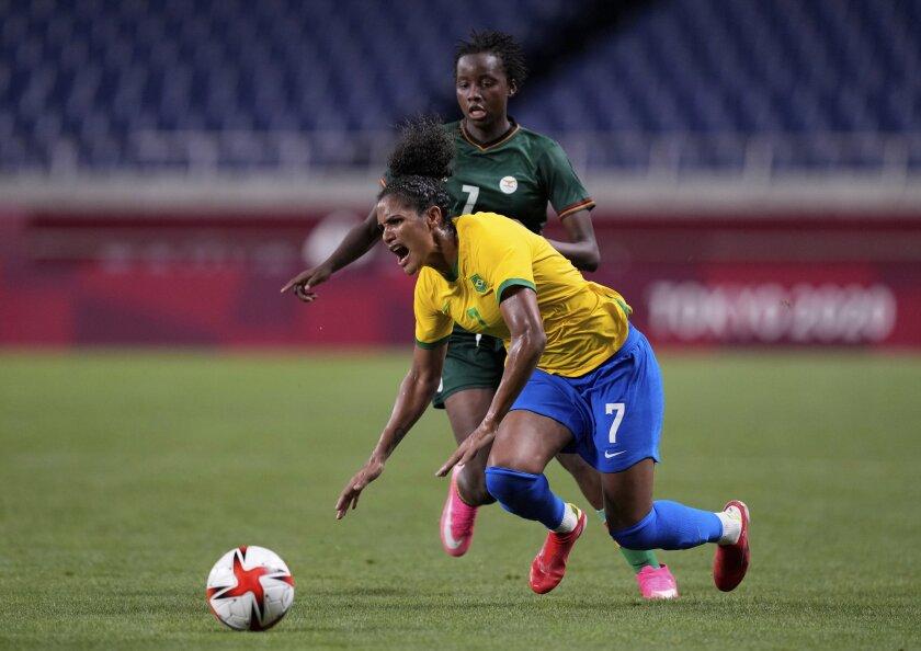 Brazil's Duda, front, is fouled by Zambia's Ochumba Lubandji during a women's soccer match at the 2020 Summer Olympics, Tuesday, July 27, 2021, in Saitama, Japan. (AP Photo/Martin Mejia)