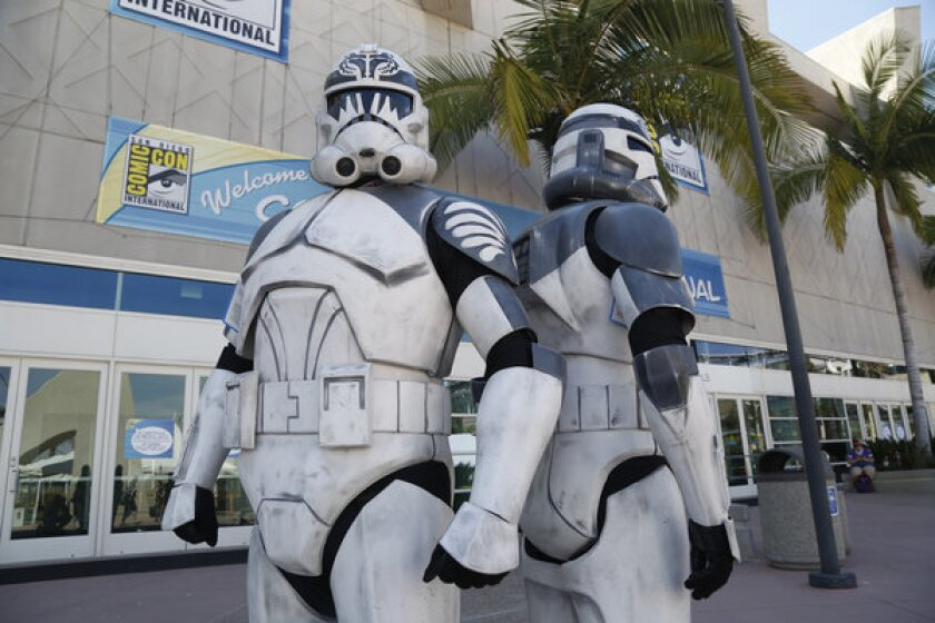 """Visitors dressed as """"Star Wars"""" storm troopers during this year's Comic-Con at the San Diego Convention Center. The center's expansion was approved Thursday by the California Coastal Commission."""