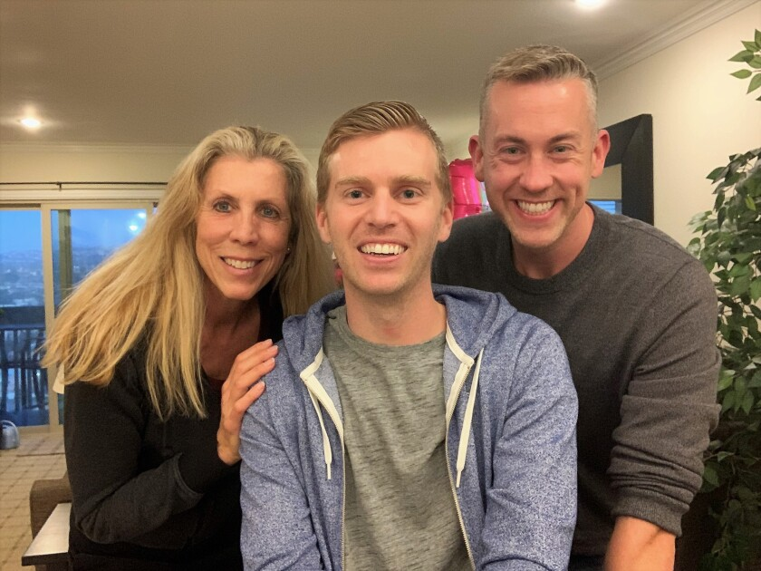 Patricia Lutfy, Kevin Nill and his partner, Bill Jefferson, celebrated Nill's recovery after he collapsed at Mission Beach.