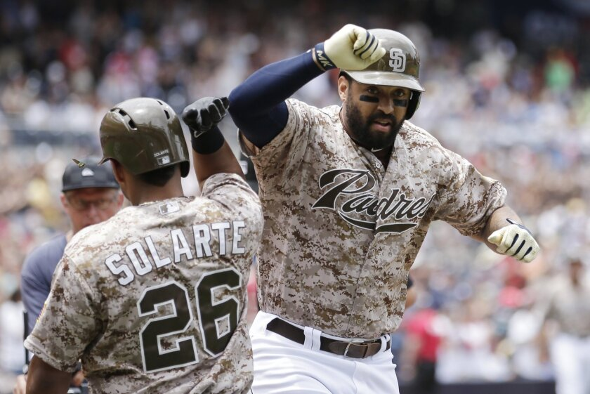 San Diego Padres' Matt Kemp, right, reacts with teammate Yangervis Solarte (26) after hitting a home run against the Arizona Diamondbacks during the first inning of a baseball game Sunday, June 28, 2015, in San Diego. (AP Photo/Gregory Bull)