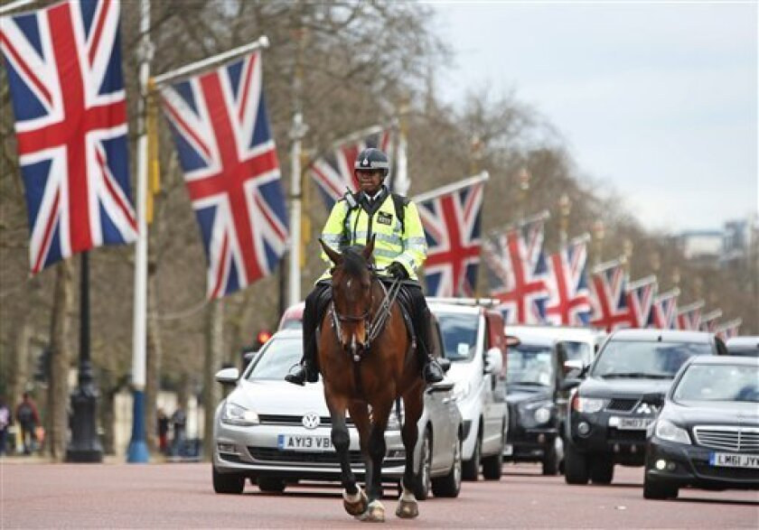 A mounted British police officer patrols the Mall in central London, Friday, April 19, 2013, where the London Marathon finish line will be on Sunday, April, 21, 2013. (AP Photo/Lefteris Pitarakis)