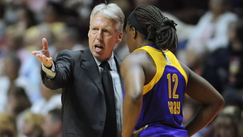 Los Angeles Sparks coach Brian Agler, left, talks with Chelsea Gray during the first half of a WNBA