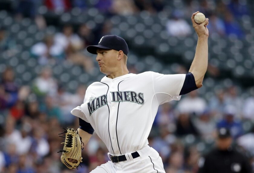 Seattle Mariners starting pitcher Mike Montgomery throws against the Kansas City Royals during the fourth inning of a baseball game Tuesday, June 23, 2015, in Seattle. (AP Photo/Elaine Thompson)