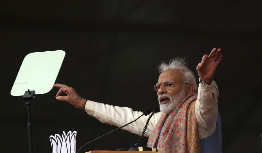 """Indian Prime Minister Narendra Modi addresses a rally of his Hindu nationalist Bharatiya Janata Party in New Delhi, India, Sunday, Dec. 22, 2019. Clashes continued Sunday between Indian police and protesters angered by a new citizenship law that excludes Muslims, as Modi used the rally to defend the legislation, accusing the opposition of pushing the country into a """"fear psychosis."""" (AP Photo)"""