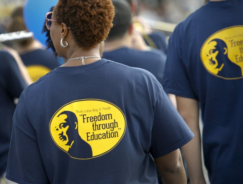 Members of  UC San Diego walk in the 34th annual Martin Luther King Jr. Parade as it makes its way along Harbor Drive.