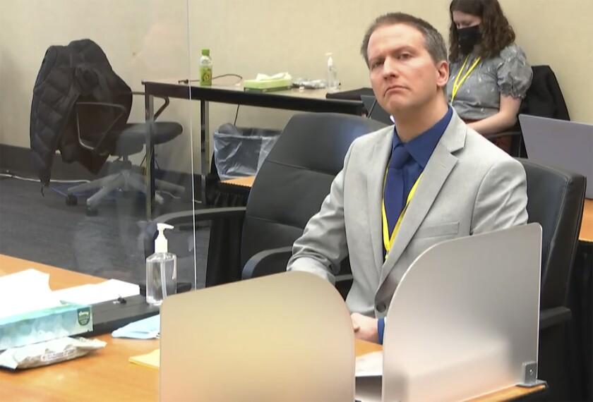 Defense attorney Eric Nelson and defendant, former Minneapolis police officer Derek Chauvin speak to Judge Peter Cahill