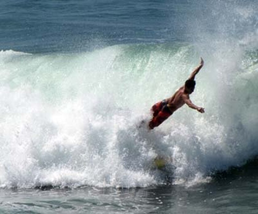A surfer wipes out at La Jolla Shores beach. Photo: S. Hinckley
