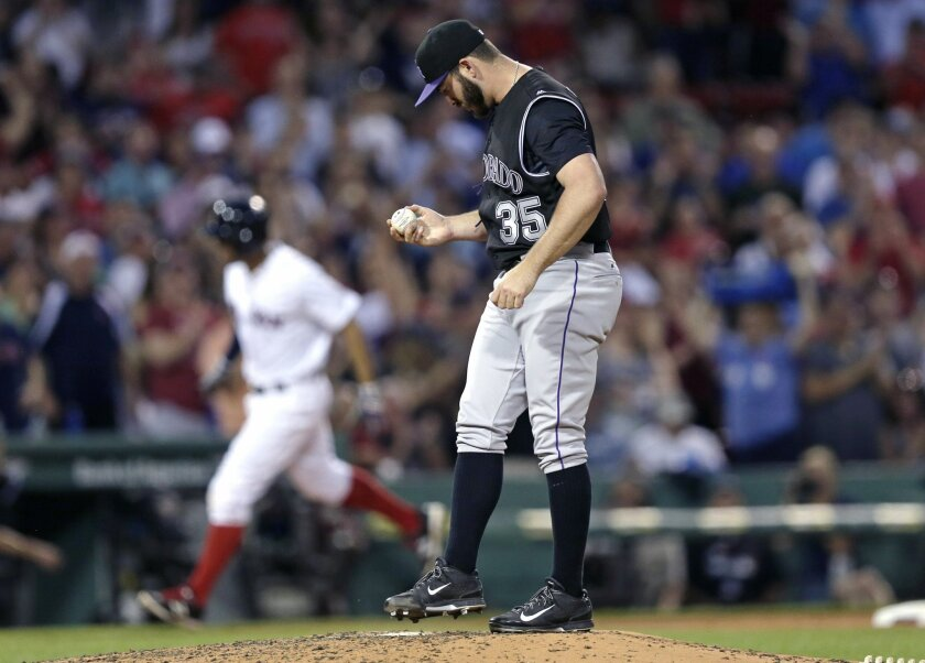 Colorado Rockies starting pitcher Chad Bettis (35) kicks at the mound as Boston Red Sox's Xander Bogaerts rounds third on a solo home run during the fourth inning of a baseball game in Boston, Wednesday, May 25, 2016. (AP Photo/Charles Krupa)