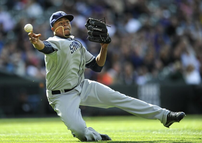 Padres starter Edinson Volquez throws to first during Sunday's game against the Rockies.