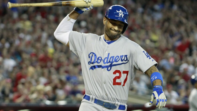 Dodgers center fielder Matt Kemp reacts after lining out with the bases loaded to end the eighth inning of the team's 5-3 loss to the Arizona Diamondbacks on Sunday.