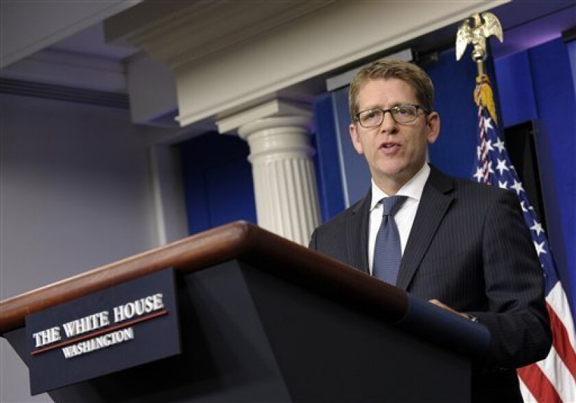 White House press secretary Jay Carney speaks during the daily briefing at the White House in Washington, Thursday, Aug. 1, 2013. Carney was asked about National Security Agency leaker Edward Snowden who left the transit zone of a Moscow airport and officially entered Russia after authorities granted him asylum for a year, his lawyer said. (AP Photo/Susan Walsh)