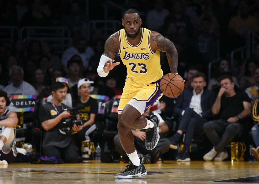 Los Angeles Lakers forward LeBron James moves the ball up court during the first half of an NBA preseason basketball game against the Sacramento Kings in Los Angeles, Thursday, Oct. 4, 2018.