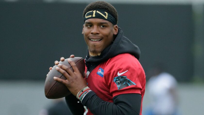 FILE - In this May 30, 2017, file photo, Carolina Panthers' Cam Newton runs a drill during an NFL fo