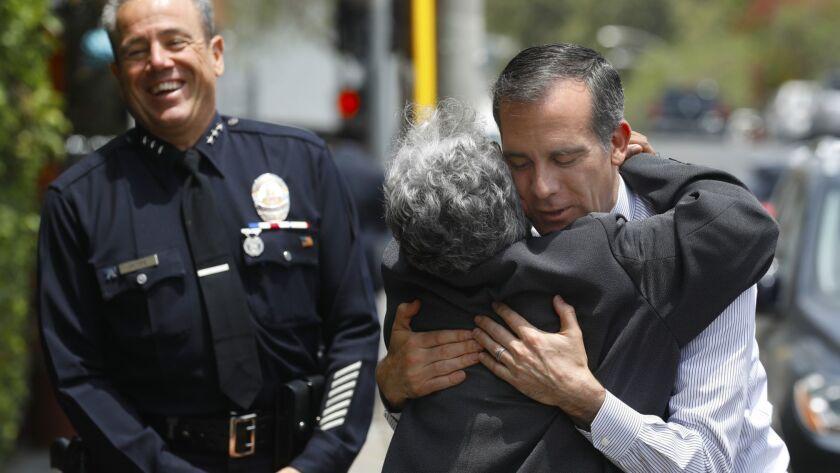 Los Angeles Police Commissioner Sandra Figueroa-Villa hugs Mayor Eric Garcetti