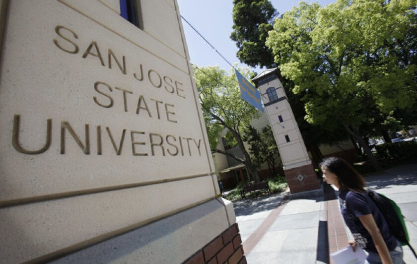 A student walks across the campus of San Jose State.