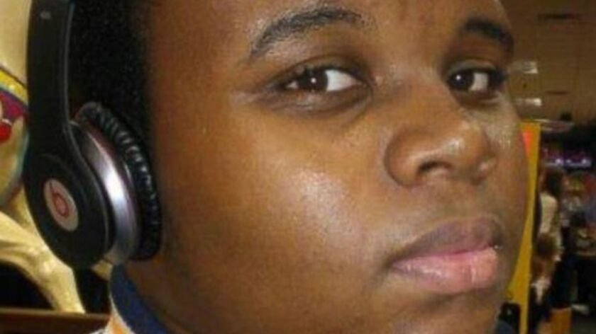 (Caption: Michael Brown photographed in Ferguson, Missouri. The world has said Mike's name over & ov
