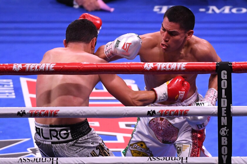 Vergil Ortiz Jr. knocks down Mauricio Herrera in the second round of their welterweight fight May 4 in Las Vegas.