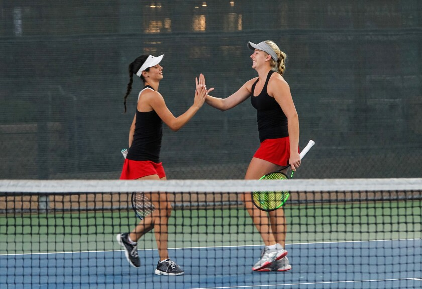 Canyon Crest's Emily Fowler (right) congratulates doubles partner Giulia Hayer en route to last year's section championship. Emily plans to team with sister Lyna Fowler in this year's postseason.