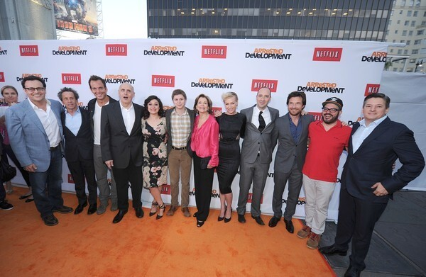 """""""Arrested Development"""" streams on Netflix starting May 26. The show took a seven-year break before being revived by the company. Here, producer Mitchell Hurwitz, left, producer Brian Grazer, actor Will Arnett, actor Jeffrey Tambor, actress Alia Shawkat, actor Michael Cera, actress Jessica Walter, actress Portia de Rossi, actor Tony Hale, actor Jason Bateman, actor David Cross and Ted Sarandos, chief content officer of Netflix arrive at the Los Angeles premiere."""
