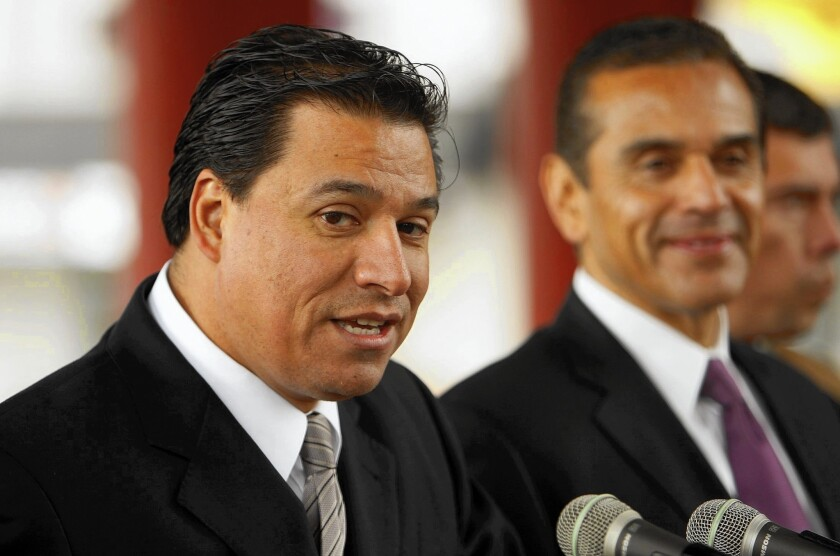 "In his debate with Gloria Molina, L.A. City Councilman Jose Huizar, left, shown with then-Mayor Antonio Villaraigosa in 2012, emphasized his work implementing ""road diets,"" reducing the number of car lanes on major streets and allocating more space for bicyclists and pedestrians."