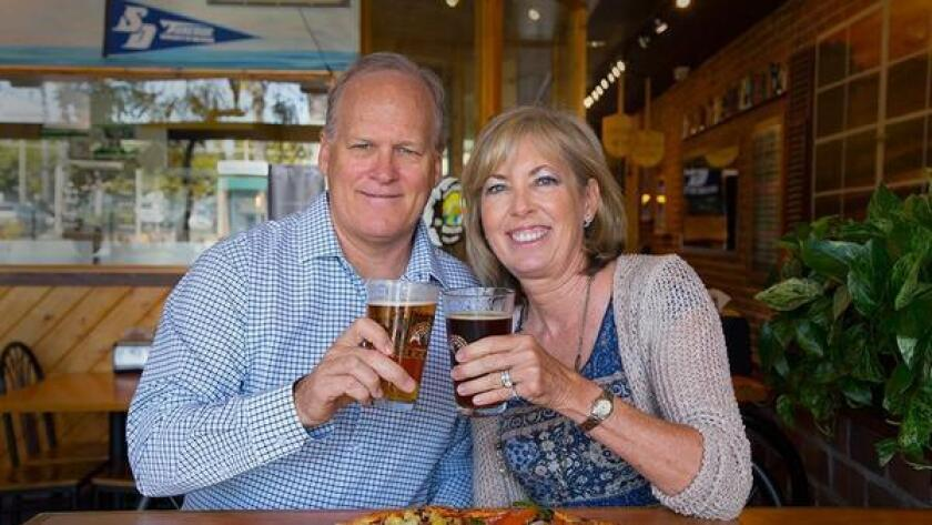 Jeff and Laura Ambrose, owners of Woodstock's Pizza. (/ Courtesy photo)