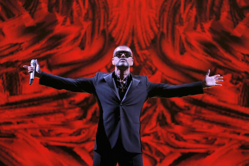 British singer George Michael performs at a concert in Paris in 2012 to raise money for an AIDS charity.
